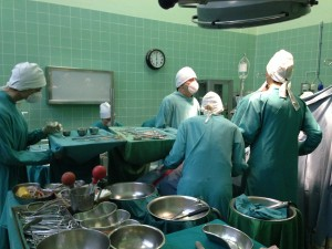 Adjacent theatre: surgeons prepare the recipient